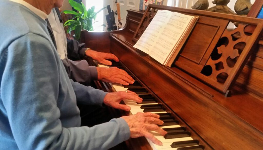 hands-on-piano-playing-music-together-as-seniors-v-ASHZ3LS